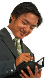Businessman Writing His Schedule