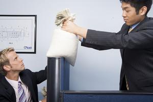 Businessmen taking money