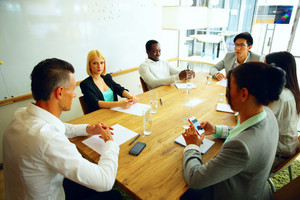 Businesspeople having meeting around table in office