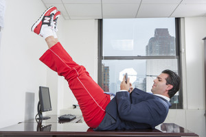 Businessperson exercising in office