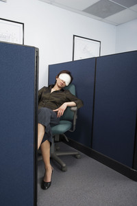 Businessperson sleeping in office