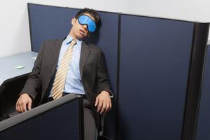 Businessperson sleeping in office