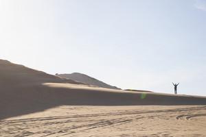 Businessperson walking in desert