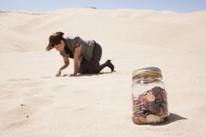 Businesswoman burying money