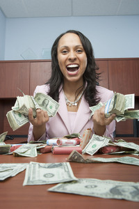 Businesswoman counting money