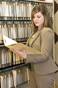 Businesswoman Examining A File