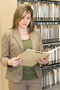 Businesswoman Examining File Folder