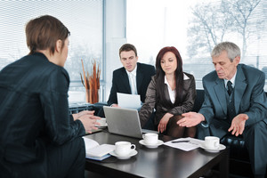 Businesswoman in an interview with three business people getting bad results