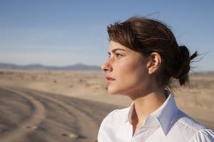 Businesswoman in desert