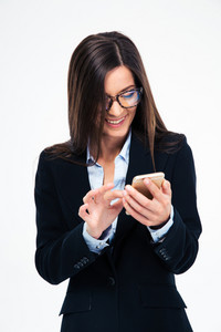 Businesswoman in glasses using smartphone