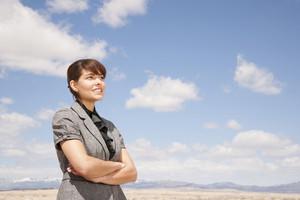 Businesswoman looking in desert