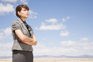 Businesswoman looking in desert