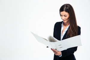 Businesswoman reading documents in folder