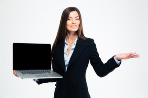 Businesswoman showing blank laptop screen