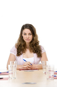 Businesswoman sitting in boardroom