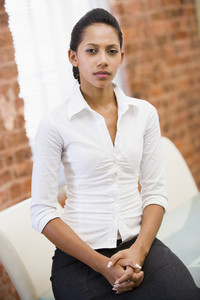 Businesswoman sitting in office space