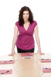 Businesswoman standing in boardroom