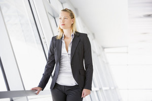 Businesswoman standing in corridor
