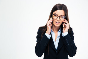 Businesswoman talking on two phones