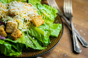 Caesar Salad On Rustic Background