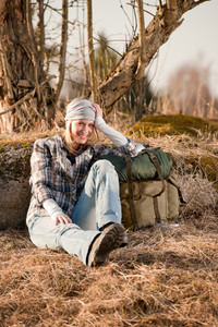 Camping young woman in countryside hiking with backpack relax