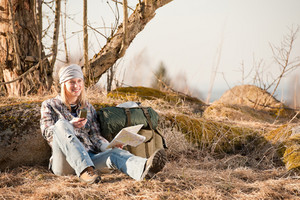 Camping young woman search navigation compass map in countryside