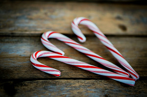 Candy Cane On Wooden Background