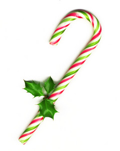Candy Cane With Pretty Holly Leaves On White Background