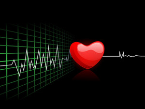Cardiogram With Red Heart Shape On Black Background