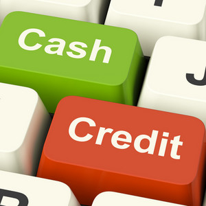 Cash And Credit Keys Showing Consumer Purchases Using Money Or Debt