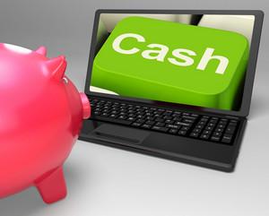 Cash Key On Laptop Showing Money Savings