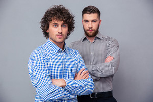 Casual businessmen standing with arms folded