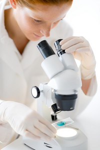 Microscope laboratory - woman medical research chemist experiment,shallow depth-of-field