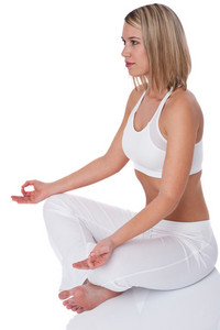 Blond woman in yoga position on white background