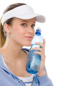 Sport - young woman in summer fitness outfit with water bottle