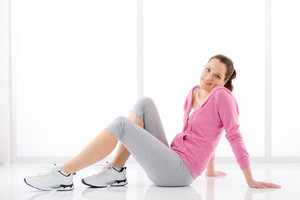 Fitness happy woman in sportive outfit on white