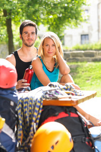 Backpack active young couple relax with climbing gear sunny terrace