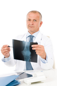 Portrait of hospital professional doctor look and point at x-ray