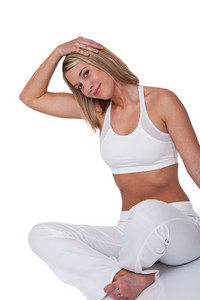 Blond woman stretching on white background