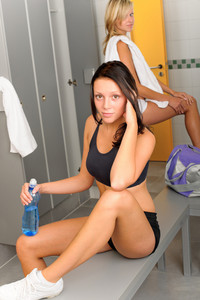 Locker room young sportive woman outfit sitting fitness training