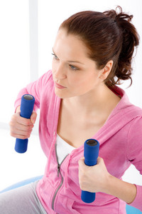 Fitness happy woman exercise with dumbbell on white