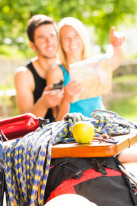 Backpack healthy young couple relax with climbing gear sunny terrace