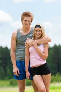 Sportive young couple happy posing in coutryside fit sportswear