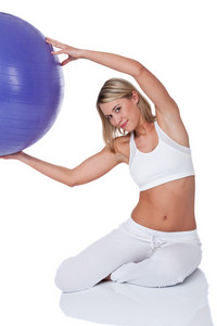 Young woman with purple ball on white background
