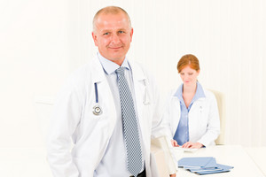 Medical team senior male doctor with professional female nurse portrait