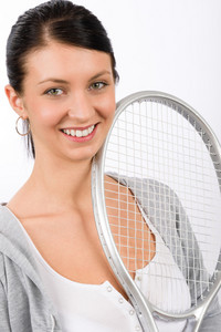 Tennis player woman young smiling holding racket isolated