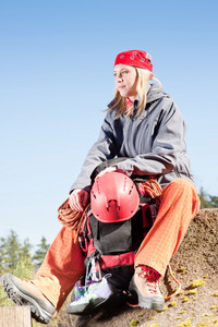 Active young woman rock climbing relax with backpack on mountain