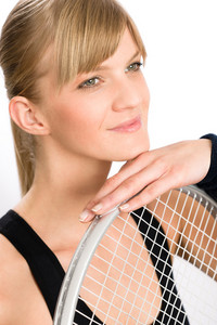 Tennis player woman young smiling leaning on racket isolated