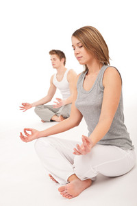 Fitness - Young healthy couple in yoga position on white background