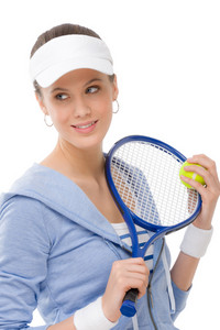 Tennis player - young woman holding racket in fitness outfit